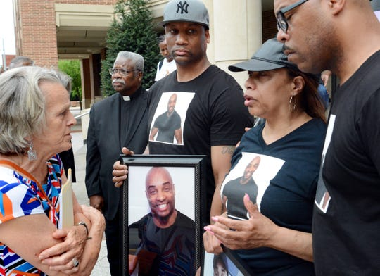 The Rev. Joan Maruskin, left, the leader of 10,000 Acts of Kindness, speaks with family members of Everett Palmer Jr. after a news conference at the York County Judicial Center on Monday, July 23, 2018. They are, from left, Palmer's brother Lamar, mother Rose and brother Dwayne. Family members and legal counsel are seeking information regarding Palmer's death while in custody at York County Prison in April. Bill Kalina photo