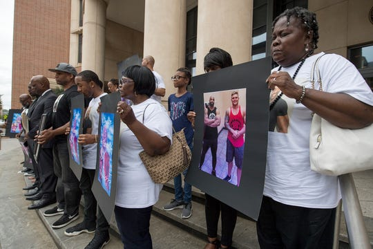 In this file photo from July 23, 2018, family members and supporters of Everett Palmer Jr. gather outside the York County Judicial Center.