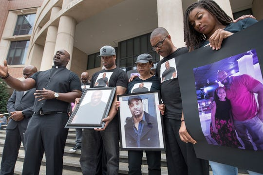 In this file photo from July 23, 2018, the Rev. A'Kim Beecham offers a prayer  brother Lamar, mother Rose, brother Dwayne and sister April Palmer outside the York County Judicial Center. Family members and supporters of Everett Palmer Jr., who died while in custody at York County Prison, rallied and demanded answers about his death.