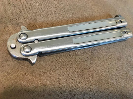 A balisong (butterfly knife) is a folding pocket knife with two handles that the blades rests in while closed. The two handles can be folded around to then expose the blade.