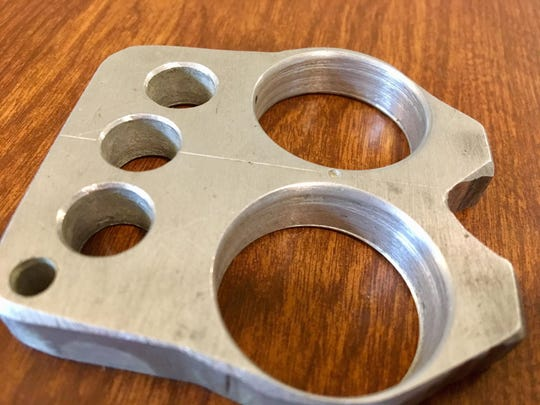 Illegal. Brass/metal knuckles are deemed to have no purposeful use other than to harm people.
