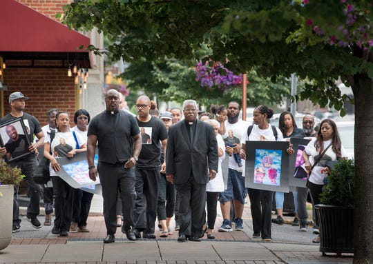 Family members and supporters of Everett Palmer Jr. walk towards the York County Judicial Center before demanding answers. Palmer died while in custody at York County Prison.