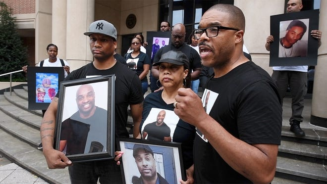 In this file photo from July 23, 2018, Dwayne Palmer, right, speaks to the media outside the York County Judicial Center. Family members  and supporters of Everett Palmer Jr., who died on April 9 while in custody at York County Prison, demanded answers about the circumstances of his death.