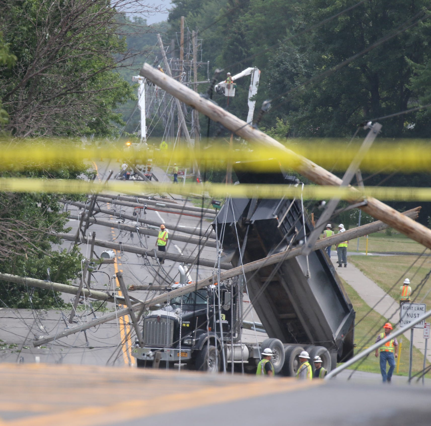 Dump truck knocks down utility poles in Henrietta leaving many without power