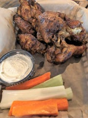 House-smoked chicken wings are among a wide variety of wing options at Ridge Runners.