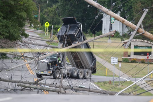 Power lines tangled in dump truck