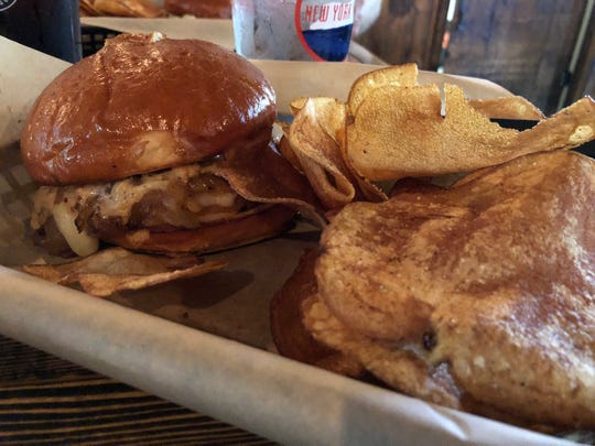 The fried bologna sandwich is covered in sautéed onions and dripping with cheese and beer mustard. All the sandwiches and burgers come with thick, salty and delicious hand-cut chips.