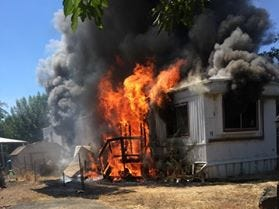 A mobile home in Cottonwood was destroyed Monday, July 23, 2018 after flamed engulfed it.