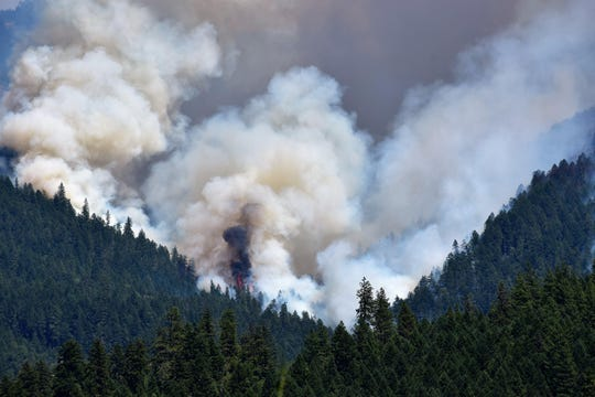 Smoke rises over the Miles Fire, part of the South Umpqua Complex in southern Oregon.