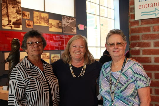From left: Volunteer Betsy Cottingham,  Stacey Weisner, president and CEO of the Discovery Center & Museum and volunteer Martha Roe pose at the Pocomoke City site..