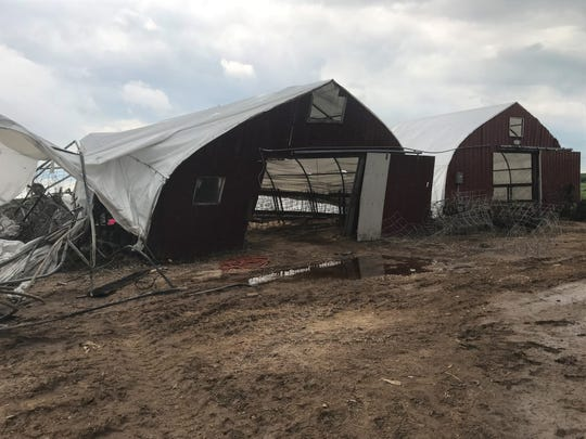 Scenes from damage sustained when a plane flew into family farm Fly-By Acres in Sheboygan Falls on Friday, July 20. The two barns destroyed housed about 80 calves between the two of them.