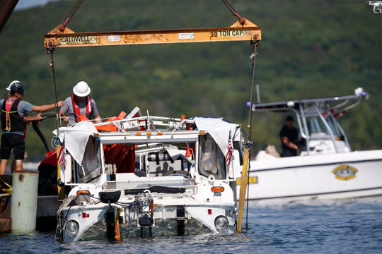 The duck boat that sank in Table Rock Lake is raised to the surface on July 23, 2018.