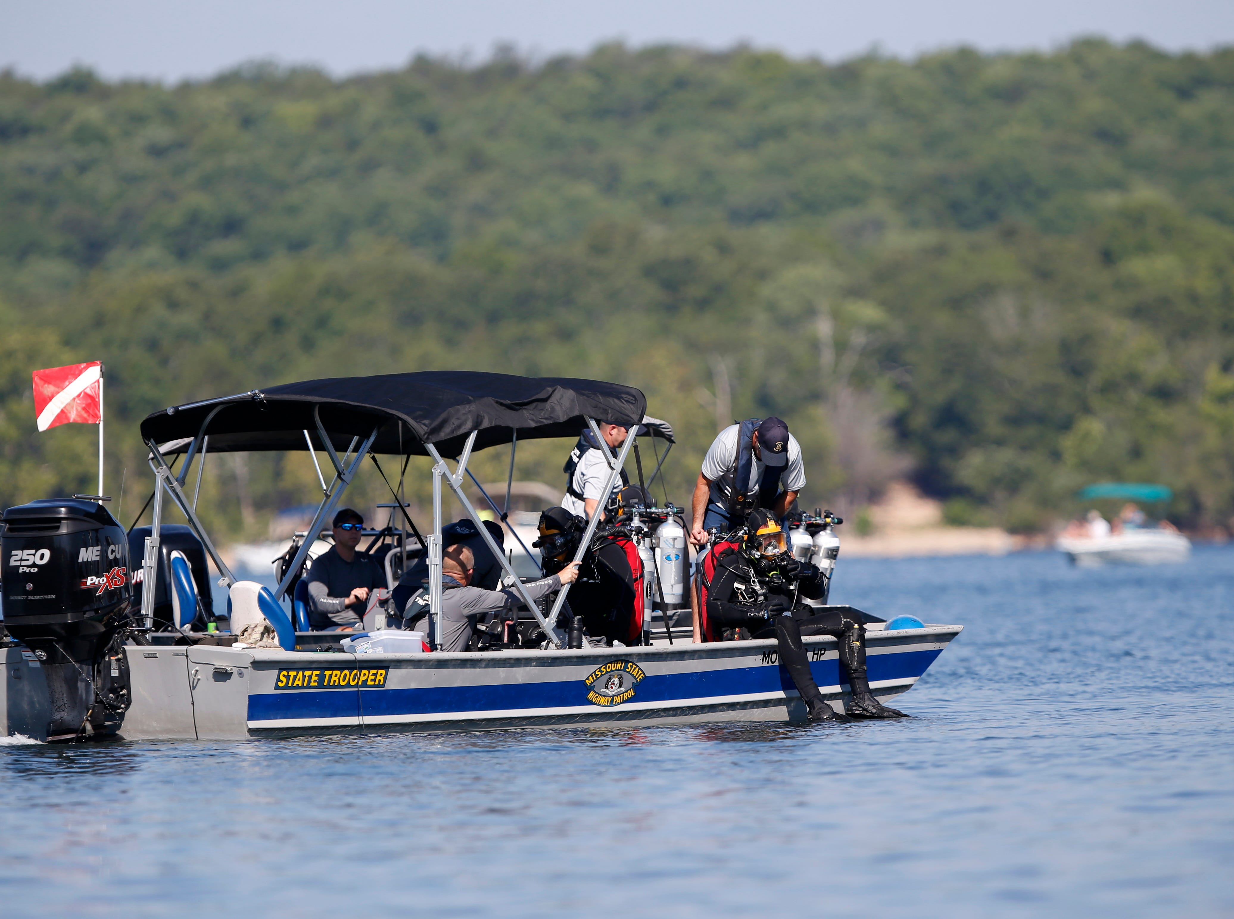 Divers in the water as part of salvage operation for the duck boat in Table Rock Lake on Monday, July 23, 2018.