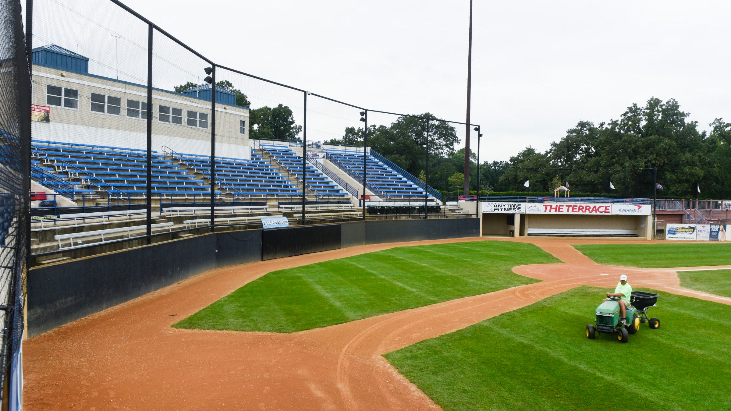 Grounds keepers work on the turf at Joe Faber Field  Monday, July 23, at the Municipal Athletic Complex. The city of St. Cloud is considering raising the food, liquor and lodging taxes to pay for improvements such as artificial turf.