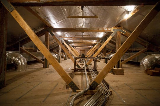 In the attic of the St. George Tabernacle, the original wooden beams have been reinforced with steel.
