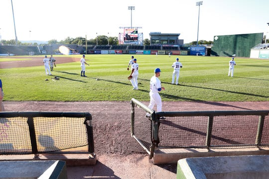 The Rockland Boulders warm up before a July 19 game.