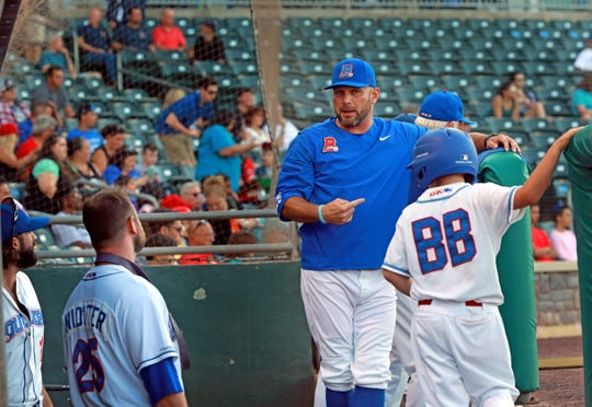Rockland Boulders manager Jamie Keefe, center, talks to his team during a game against the Quebec Capitales on July 19.