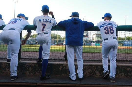 Boulders players watch their teammates during a game against the Quebec Capitales on July 19.