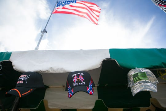 A vendor at the Delaware State Fair selling confederate hats.