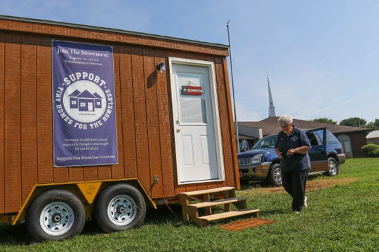 Cathi Kopera, co-founder of Port Hope Delaware, outside of a mobile tiny home model she hopes will serve as affordable housing for the homeless in Kent County. The original tiny house movement stalled at Victory Church in Dover, but a grant has signaled the effort's rebirth.