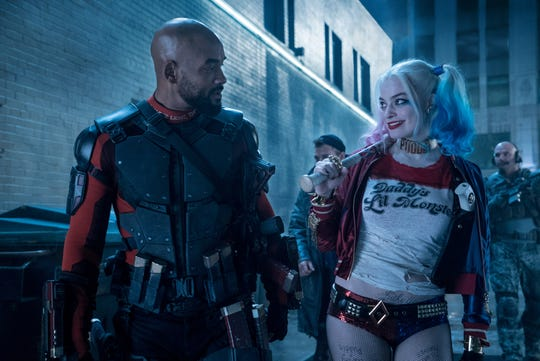 "Deadshot (Will Smith) and Harley Quinn (Margot Robbie) have to save the world in ""Suicide Squad."""
