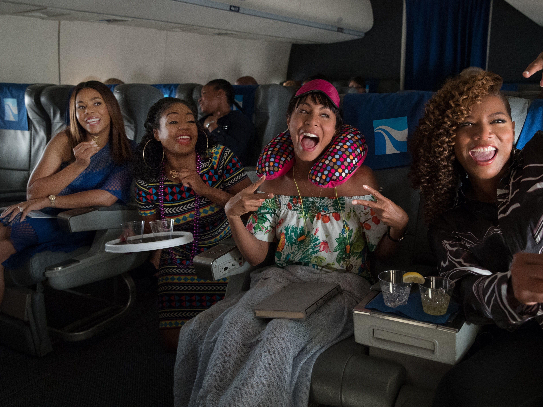 Regina Hall (left), Tiffany Haddish, Jada Pinkett Smith and Queen Latifah find inflight fun in 'Girls Trip.'