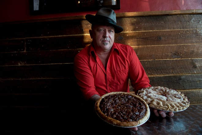 Rodney Henry poses for a portrait at his pie shop, Dangerously Delicious Pies.