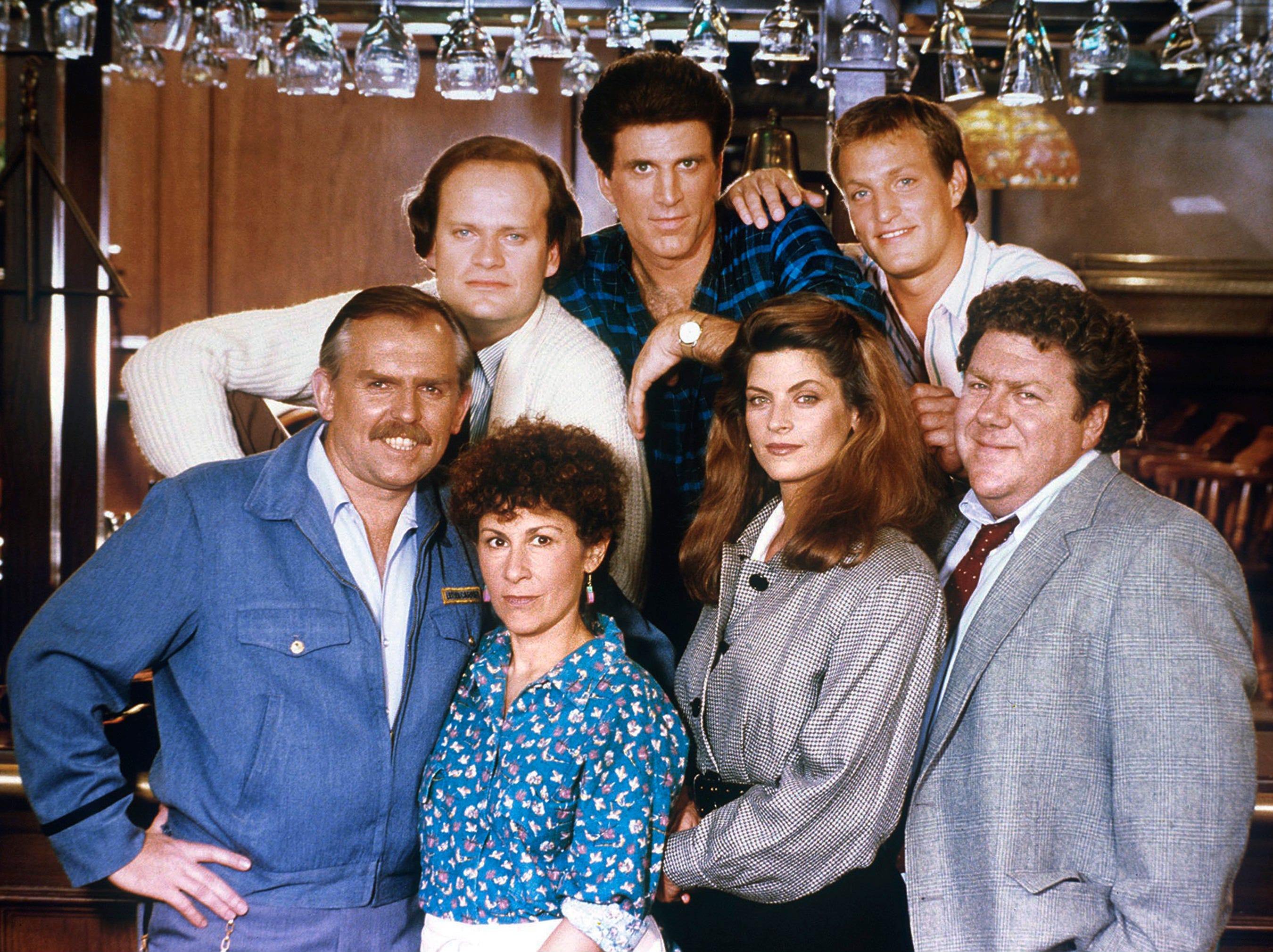 CHEERS -- Pictured: (top) Kelsey Grammer as Dr. Frasier Crane, Ted Danson as Sam Malone, Woody Harrelson as Woody Boyd, (bottom) John Ratzenberger as Cliff Clavin, Rhea Perlman as Carla Lozupone Tortelli LeBec,  Kirstie Alley as Rebecca Howe, George Wendt as Norm Peterson -- (Photo by: NBC)