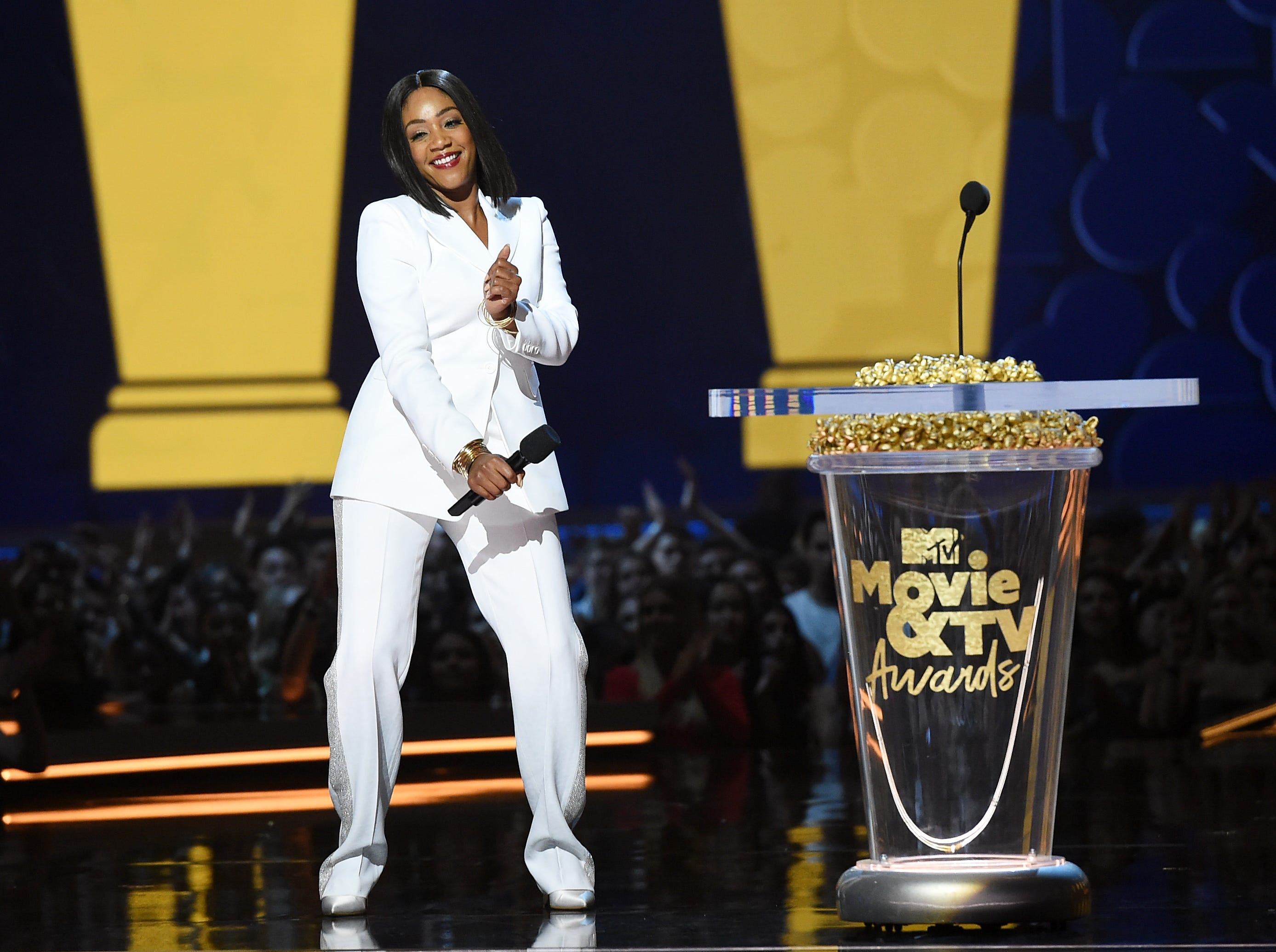 SANTA MONICA, CA - JUNE 16:  Host Tiffany Haddish speaks onstage during the 2018 MTV Movie And TV Awards at Barker Hangar on June 16, 2018 in Santa Monica, California.  (Photo by Kevin Winter/Getty Images for MTV) ORG XMIT: 775176642 ORIG FILE ID: 978197422
