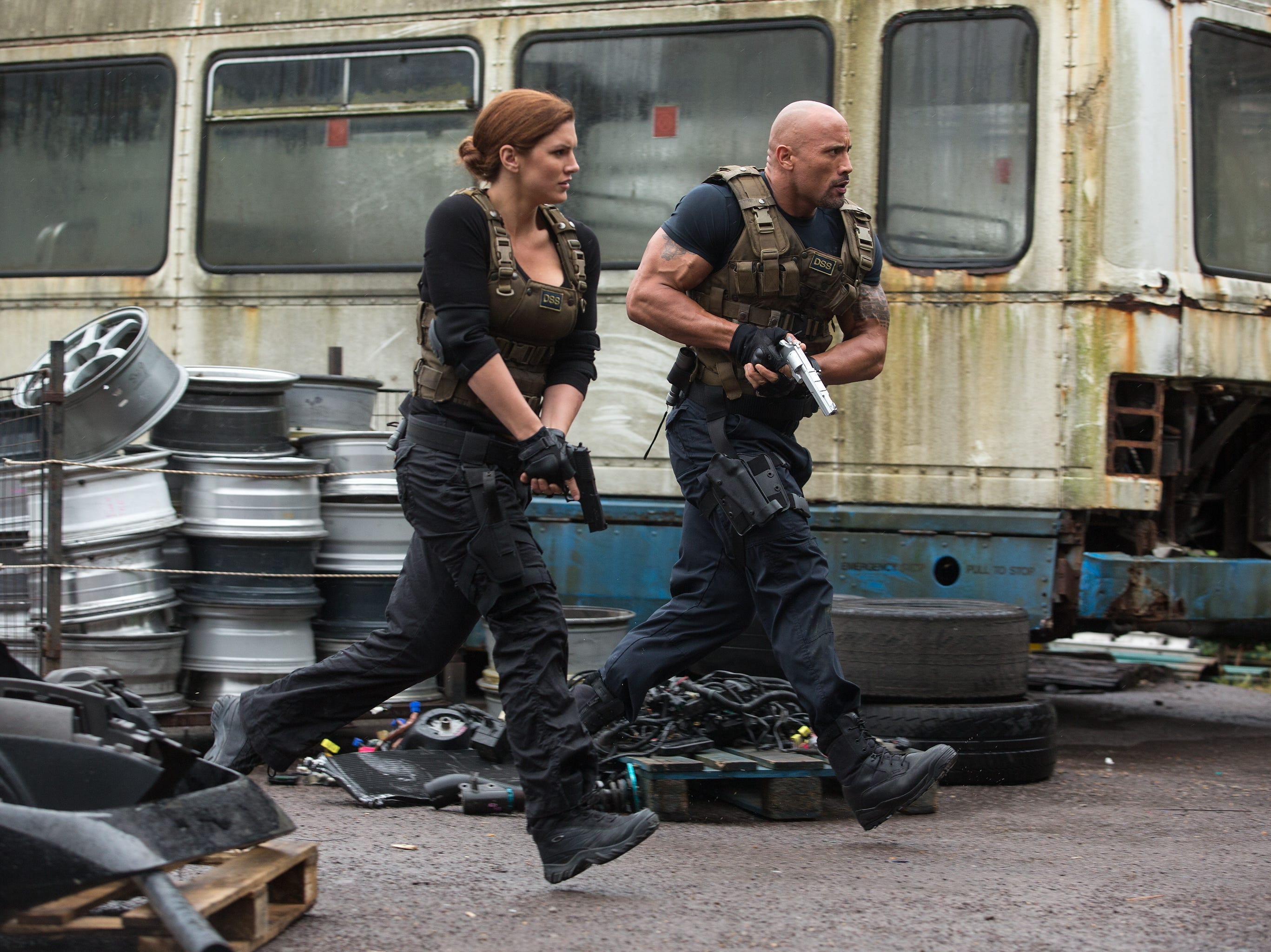 Hobbs (DWAYNE JOHNSON) and Riley (GINA CARANO) lead their strike team in a scene from the motion picture 'Fast & Furious 6.' Credit: Giles Keyte, Universal Pictures [Via MerlinFTP Drop]