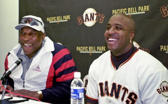 Willie McCovey (left) and Barry Bonds appear together at a press conference in 2001.