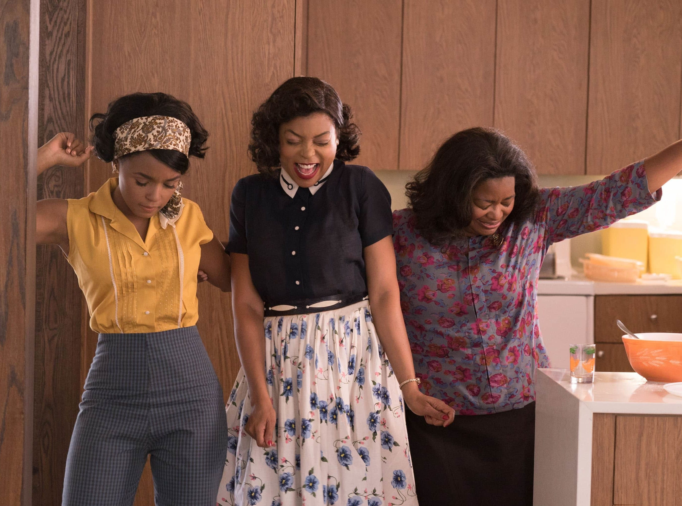 Mary Jackson (Janelle Monae, left), Katherine Johnson (Taraji P. Henson) and Dorothy Vaughan (Octavia Spencer) take time to dance in the period drama 'Hidden Figures.'