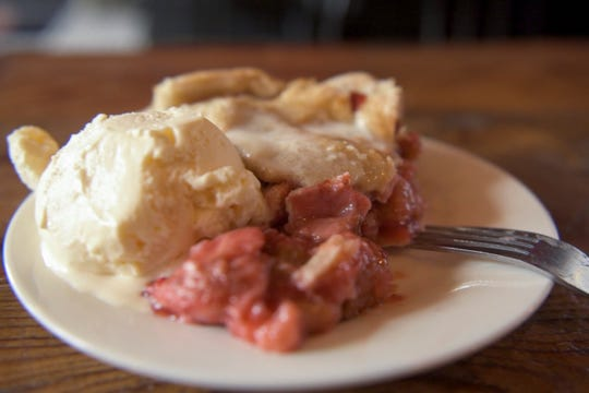 A slice of strawberry-rhubarb pie, served a la mode, awaits a hungry patron of Dangerously Delicious Pies.