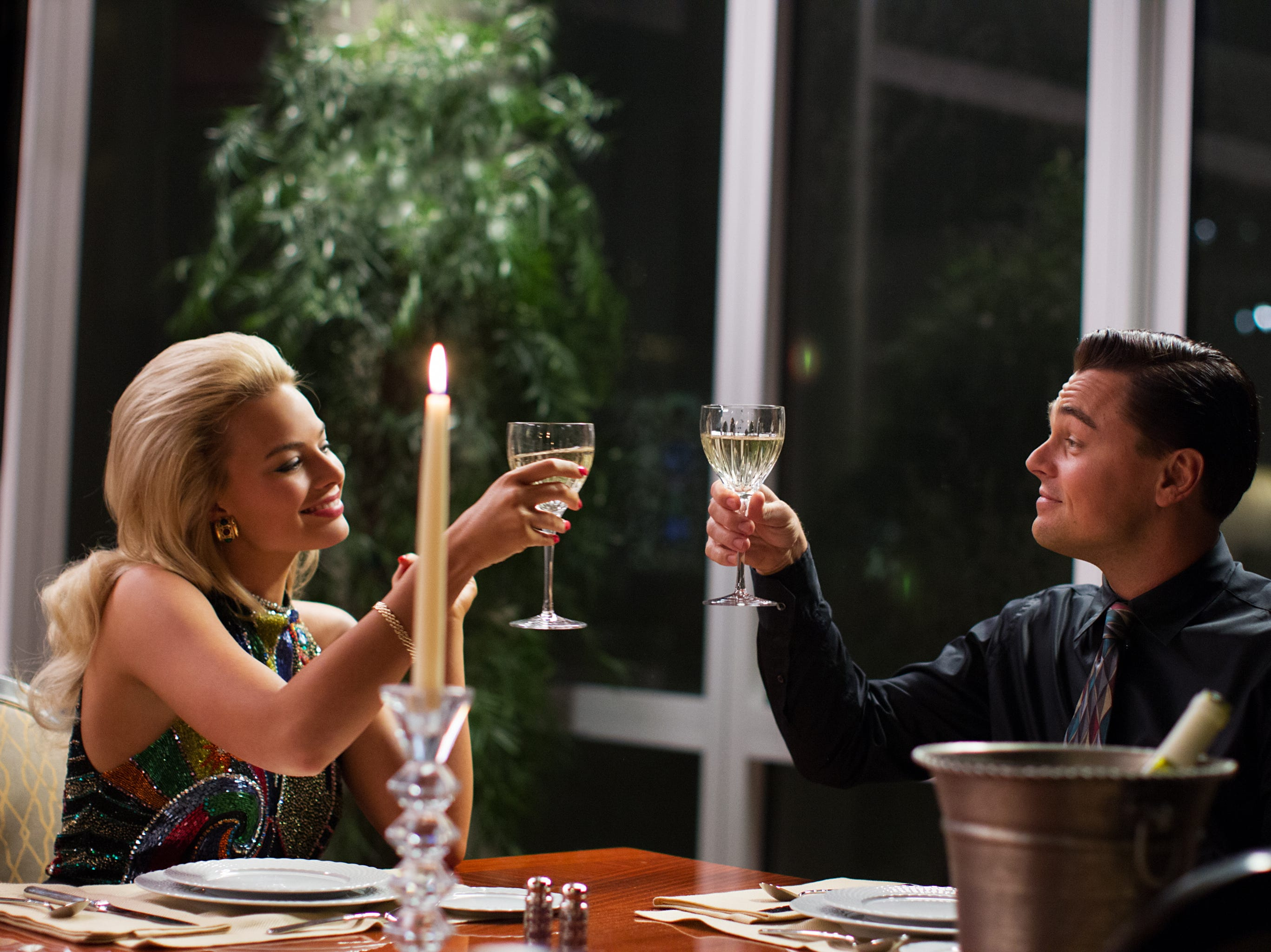 Left to right: Margot Robbie is Naomi Lapaglia and Leonardo DiCaprio is Jordan Belfort in in a scene from the motion picture THE WOLF OF WALL STREET, from Paramount Pictures and Red Granite Pictures. TWOWS-04645Rv2 Credit: Mary Cybulski, Paramount Pictures  [Via MerlinFTP Drop]