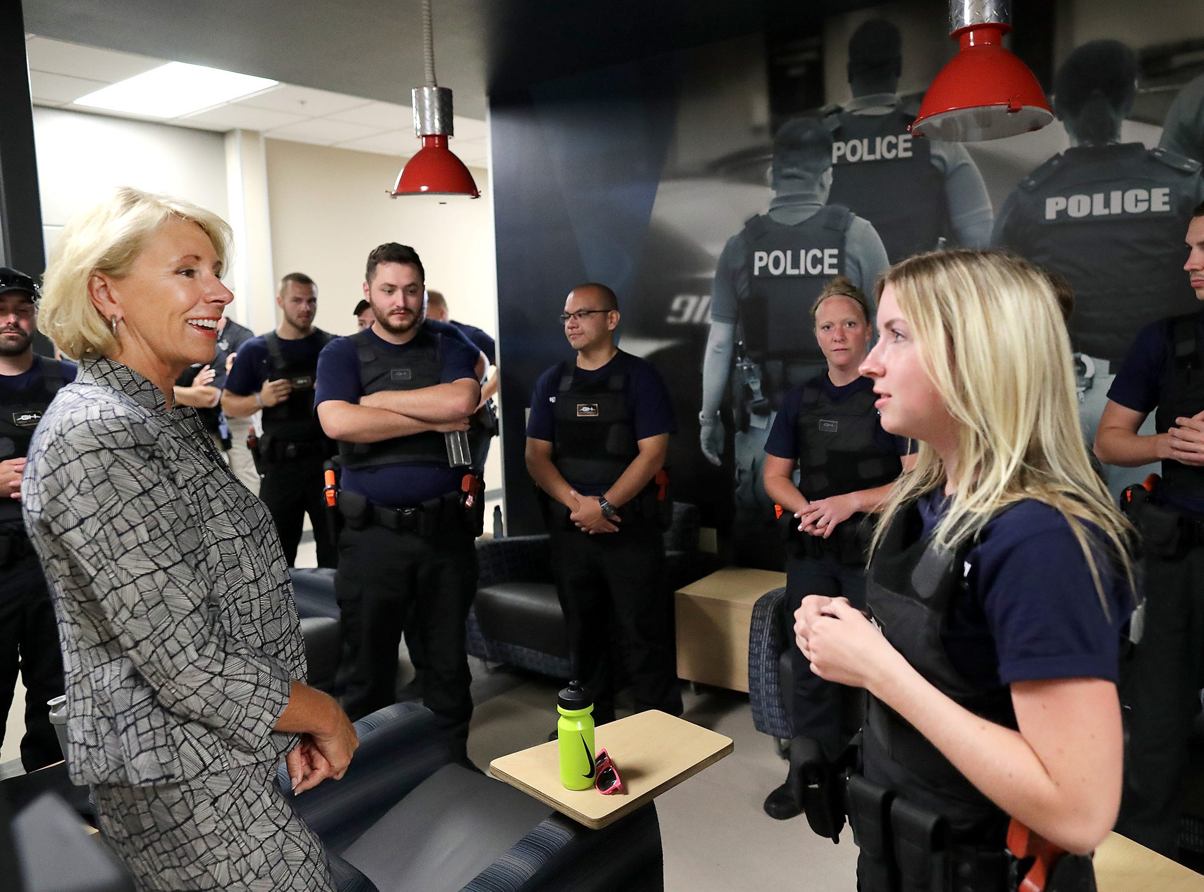 U.S. Secretary of Education Betsy DeVos talks with students while taking a tour to see firsthand how Fox Valley Technical CollegeÕs Public Safety Training Center is merging classroom lessons with reality-based hands-on training on Tuesday, July 24, 2018 in Greenville, Wis. Wm. Glasheen/USA TODAY NETWORK-Wisconsin