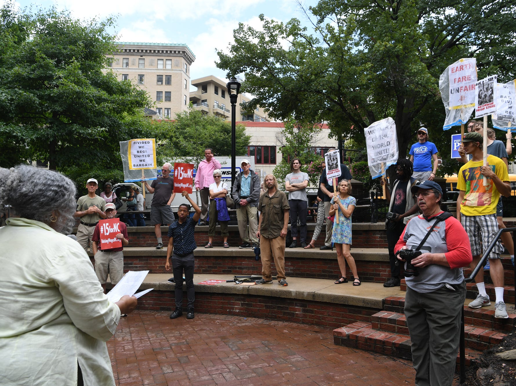 "People gathered at Pritchard Park to rally for raising wages in North Carolina July 24, 2018, the anniversary of the last wage increase, which was in 2009. The group chanted ""we can't survive on $7.25,"" the current minimum wage in North Carolina and called to support businesses that display ""living wage certified"" stickers in their windows."