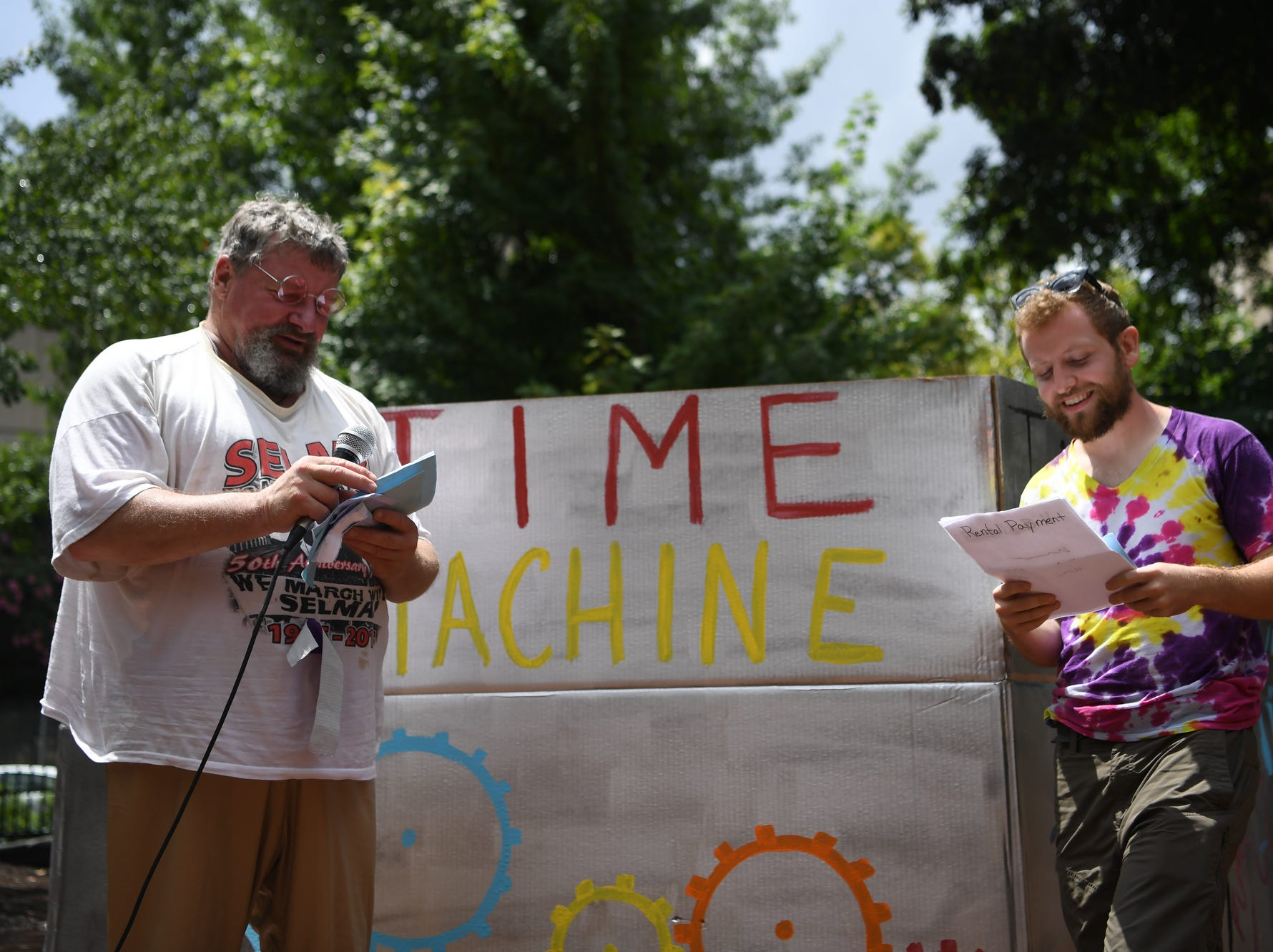 """People gathered at Pritchard Park to rally for raising wages in North Carolina July 24, 2018, the anniversary of the last wage increase, which was in 2009. The group chanted """"we can't survive on $7.25,"""" the current minimum wage in North Carolina and called to support businesses that display """"living wage certified"""" stickers in their windows."""