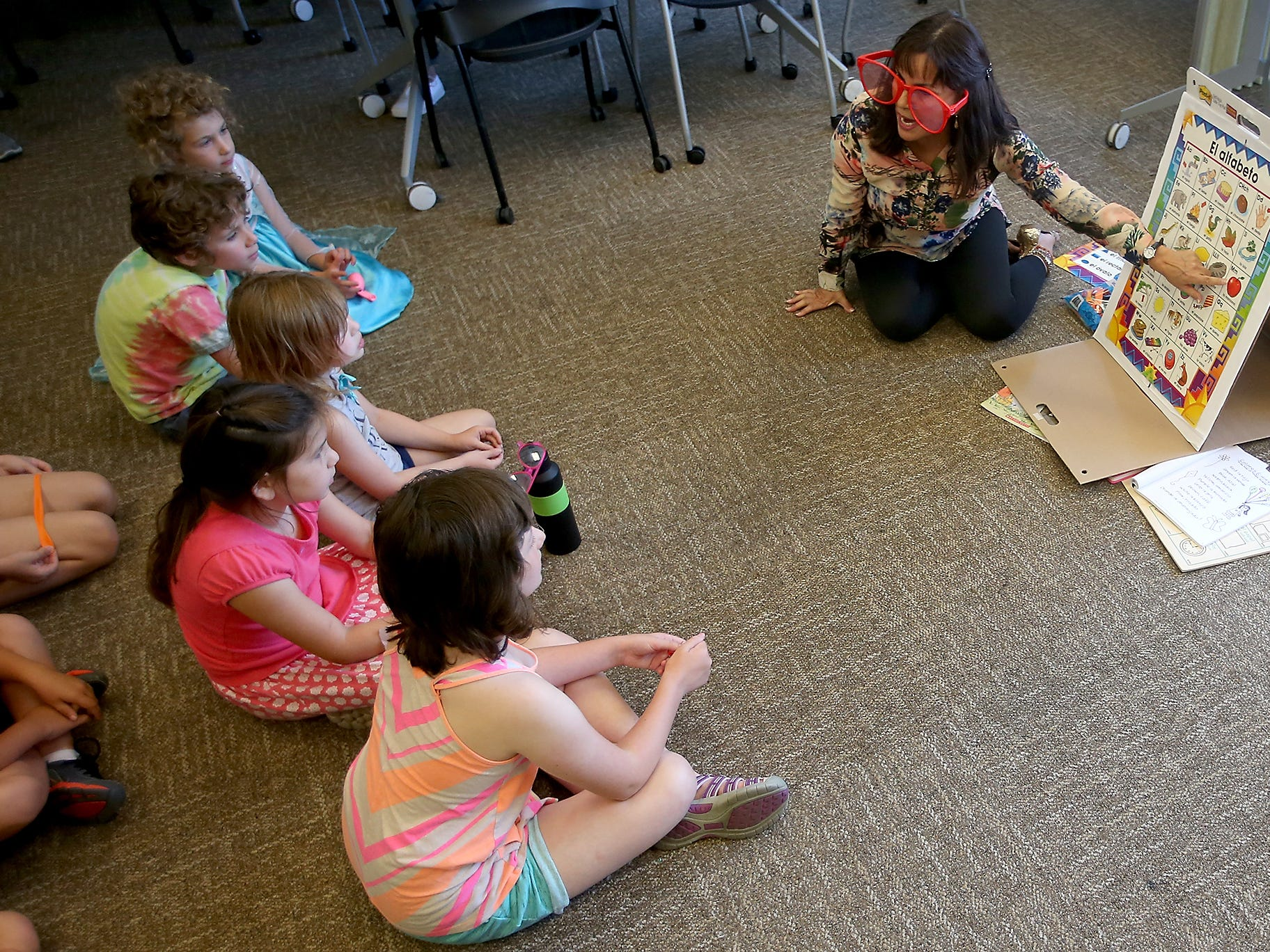 """Ruth Carlson hosts a Spanish Immersion """"Story Time"""" at the Port Orchard Library on Monday, July 23, 2018."""