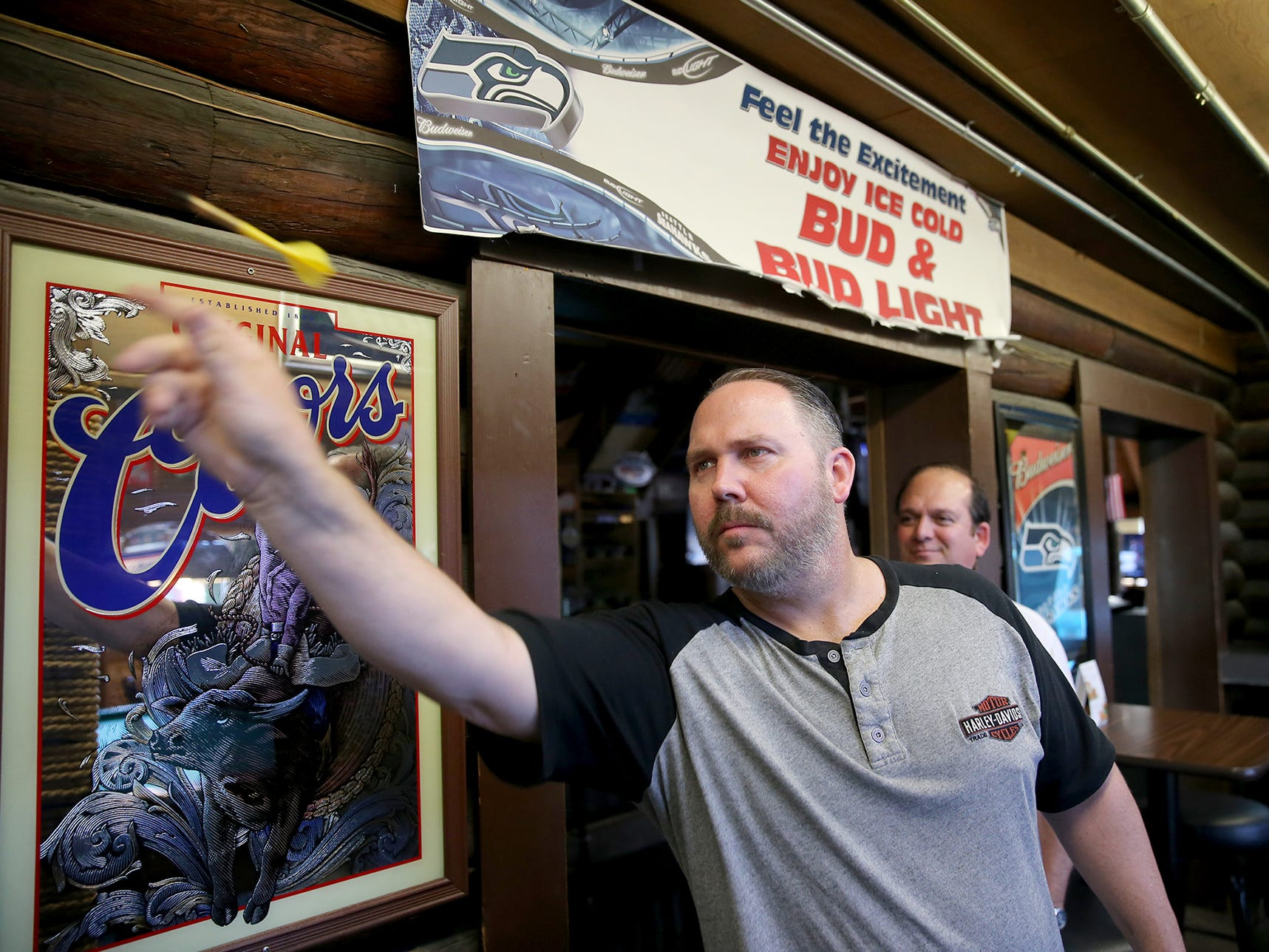 Our Place Pub and Eatery regular customer Joey VanVuren, of Silverdale, throws darts.
