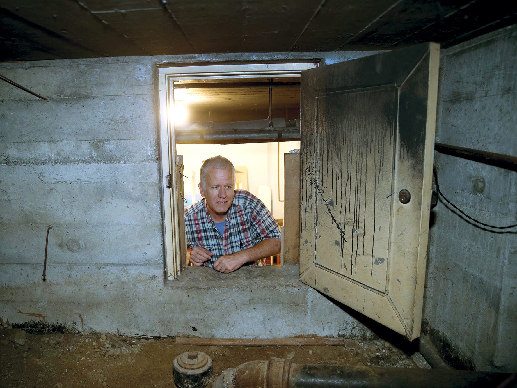 Inside a crawl space within Glenn and Lori Stockwell's home is a window into the history of World War II Bremerton. It appears their home was a training spot for air raid wardens, workers who lived on every block in the city and trained to ensure all was dark in the event of an air assault on Bremerton. The Stockwell's just discovered all the training and job materials in the crawl space, more than 70 years after the war's end.