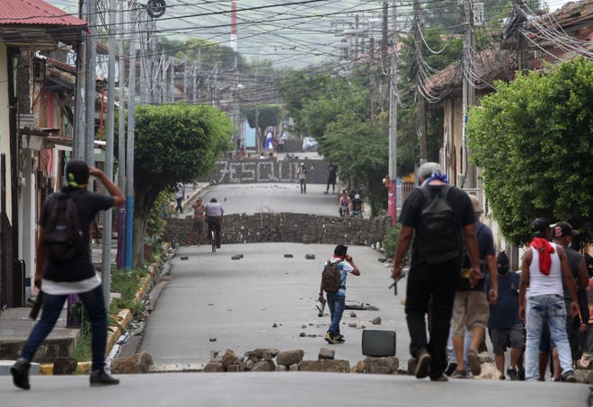 Barricades raised by opponents of the government of President Daniel Ortega block roads during clashes in Masaya, Nicaragua last month.
