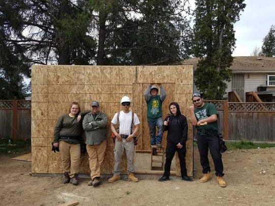 From left, Jasmine Murphy, Dino Davis of Habitat for Humanity, Trenton Roark, Spencer Capdepon, Addison Redd and Quantae Andrada built a shed at a Habitat for Humanity of Kitsap County build site.