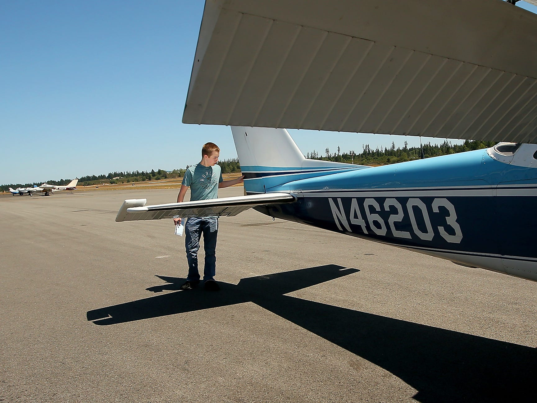 Bremerton Pilots Association scholarship recipient Aidan Hurley goes through his pre-flight checklist prior to a flight at the Bremerton National Airport on Monday, July 16, 2018.
