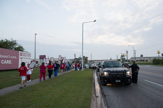 Corpus Christi police respond to a demonstration by registered nurses and supporters outside Corpus Christi Medical Center-Bay Area on Tuesday, July 24, 2018.