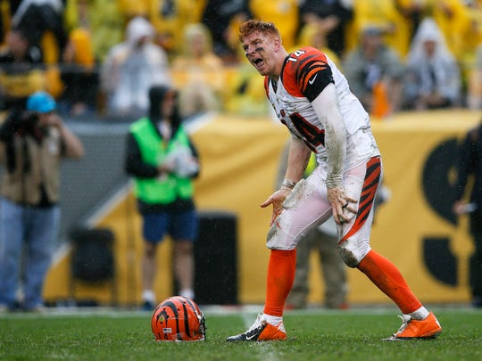 Cincinnati Bengals quarterback Andy Dalton (14) pleads his case to an official in the third quarter during the Week 2 NFL football game between the Pittsburgh Steelers and the Cincinnati Bengals, Sunday, Sept. 18, 2016, at Heinz Field in Pittsburgh. At the half, Pittsburgh leads, 10-6.