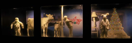 """This year's butter display features scenes from """"A Christmas Story,"""" including Ralphie in his bunny pajamas, a Christmas tree decorated with real lights, Randy in his snowsuit, the iconic leg lamp and the butter calf and Flick with their tongues stuck to a pole, while the traditional butter cow looks on."""