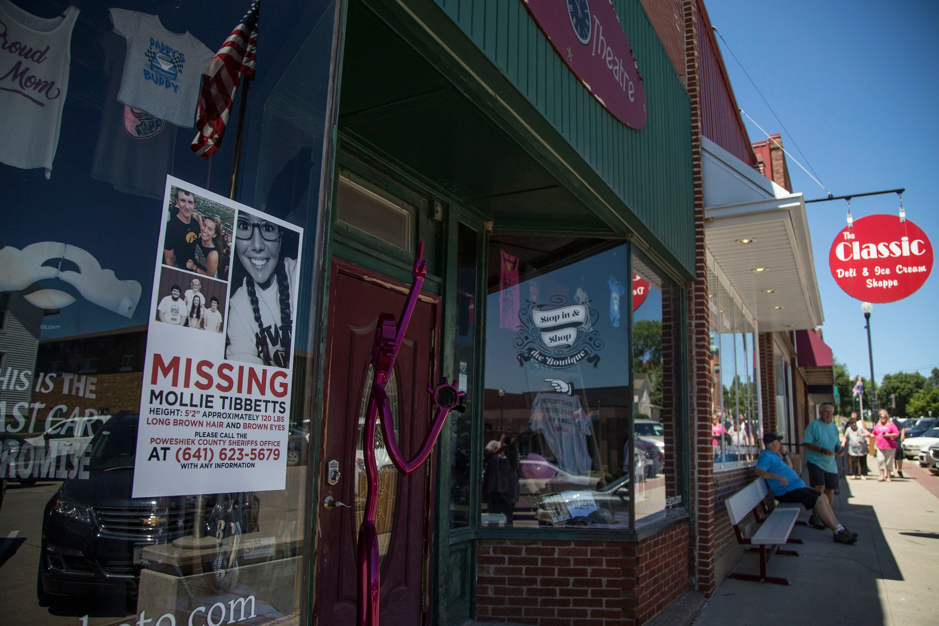 A poster with information about Mollie Tibbetts hangs in the window of a business in downtown Brooklyn.