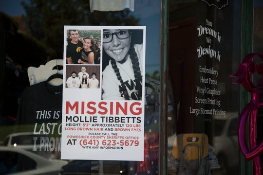 A poster with information about Mollie Tibbetts, a missing 20-year-old University of Iowa student, hangs in the window on a business in downtown Brooklyn on Tuesday, July 24, 2018, in eastern Iowa.