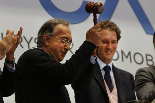 Sergio Marchionne, chief executive officer, Fiat Chrysler Automobiles, left, and John Elkann, chairman, Fiat Chrysler Automobiles, ring the closing bell on the floor of the New York Stock Exchange in October 2014 in New York City.