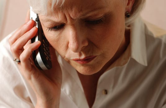 Distraught Woman On Cell Phone